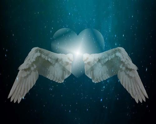 wings surrounding a heart in outer space